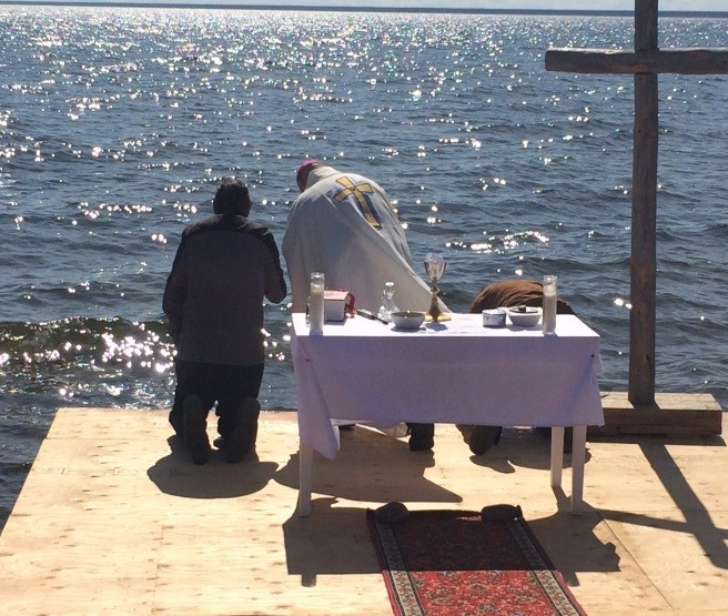 At the end of the Mass, several elders joined with Bishop Mark in blessing themselves and thanking God for His gift of the Water of the Great Lake.