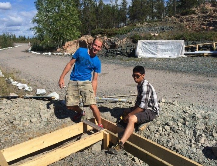 Sebastien and Douglas work on a new garage at the Retreat Center.