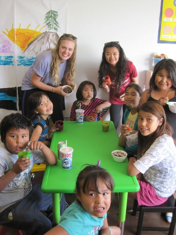 Maria Wilson and Brenna Maduro assist in a youth program with  young people in the northern Decho community of Wrigley.